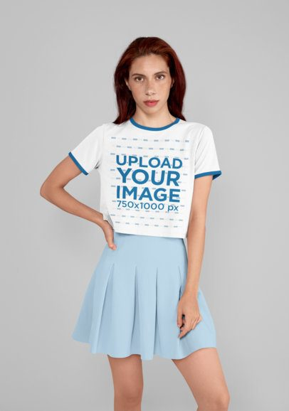 Mockup of a Woman Wearing a Ringer T-Shirt and a Skirt at a Studio 27253