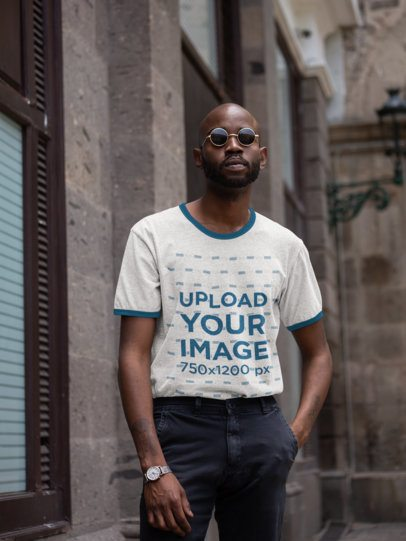 Ringer Tee Mockup of a Man with Sunglasses Posing by Some Stone Buildings 27911