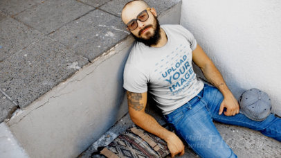 T-Shirt Video of a Man Resting in The Street 12265