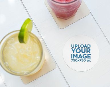 Mockup of a Round Coaster Next to a Lemonade over a White Wooden Surface 27792