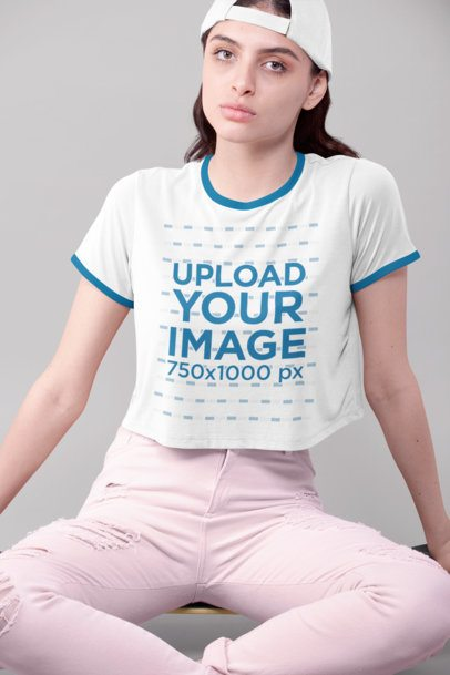 Crop Top Ringer Tee Mockup Featuring a Woman Sitting in a Studio 27187