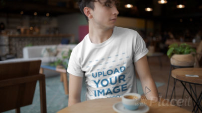 T-Shirt Video Featuring a Young Man Drinking Coffee 22457