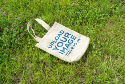 Mockup of a Tote Bag Lying on the Grass 27-el