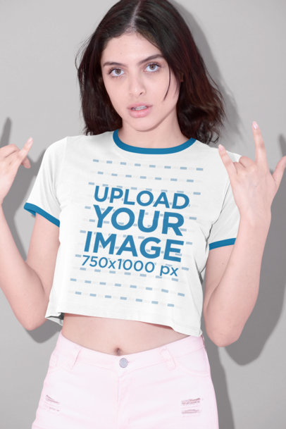 Ringer T-Shirt Mockup of a Woman Doing the Rock and Roll Sign 27189