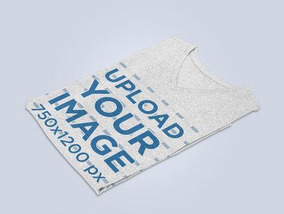 Mockup of a Folded Heathered V-Neck T-Shirt on a Plain Surface 27685