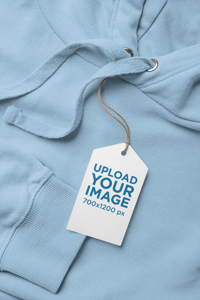 Mockup of a Clothing Tag Lying on a Hoodie 27662