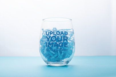 Mockup of a Stemless Wine Glass Filled with Colored Shredded Paper 27934