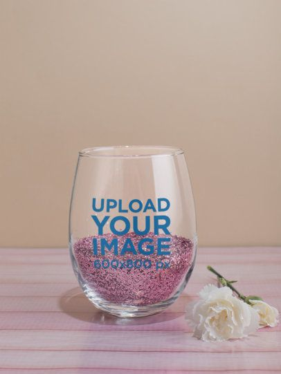Stemless Wine Glass Mockup Featuring Pink Glitter and a White Carnation 27941