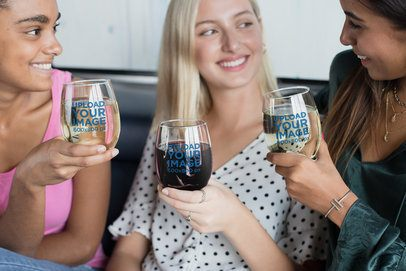 Mockup of Three Women Smiling and Holding Stemless Wine Glasses 27952