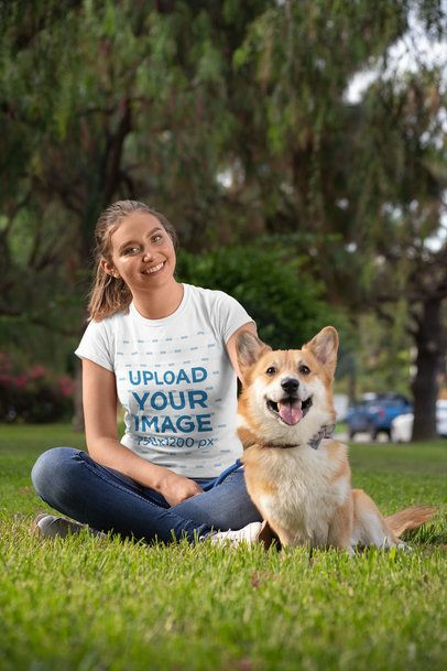 Shirt Mockup of a Young Woman with a Corgi in a Park 28038