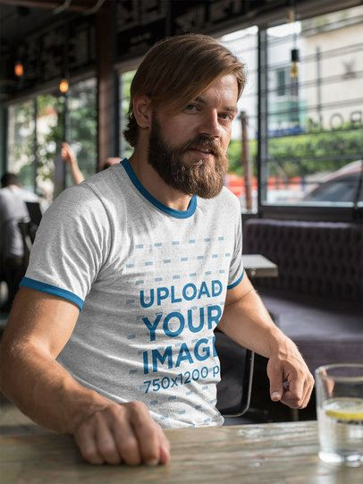 Ringer T-Shirt Mockup of a Man at a Restaurant 27918