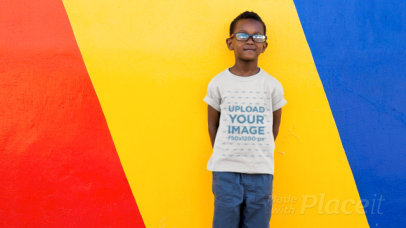 T-Shirt Video of a Happy Kid Posing Against a Colorful Wall 12588