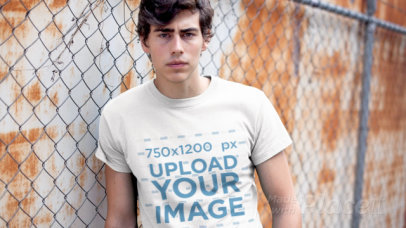 T-Shirt Video Featuring a Young Man Leaning Against a Rusty Wall 12137