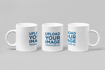 Mockup Featuring Three 11 oz Coffee Mugs Standing Side by Side 27889