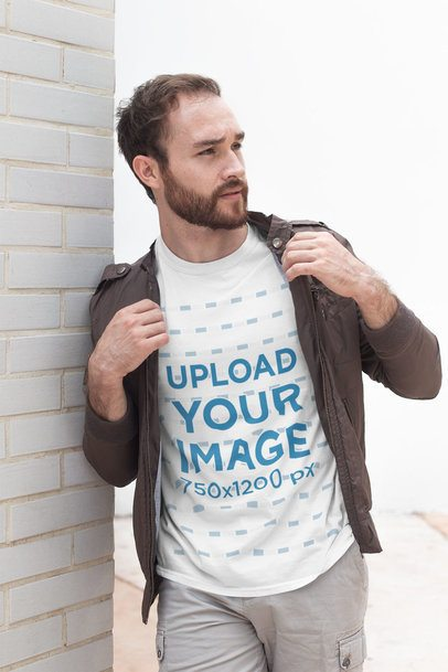 Shirt Mockup of a Bearded Man Leaning Against a White Brick Wall 28189