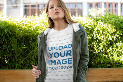 T-Shirt Mockup of a Young Woman Wearing a Huntress Jacket 28205