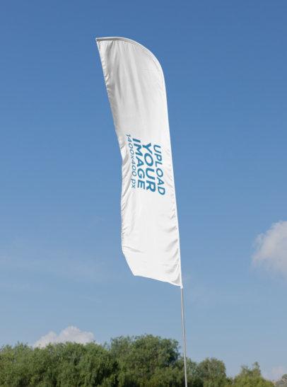 Mockup of a Flag Banner at a Park 28029