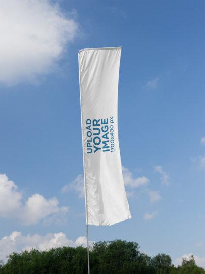 Flag Banner Mockup Against a Blue Sky Backdrop 28034