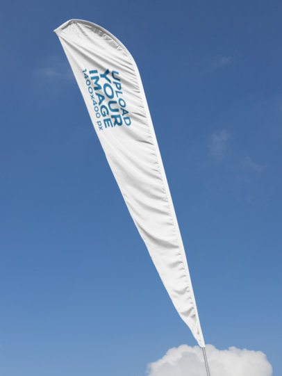 Teardrop Flag Banner Mockup with a Clear Sky Background 28014
