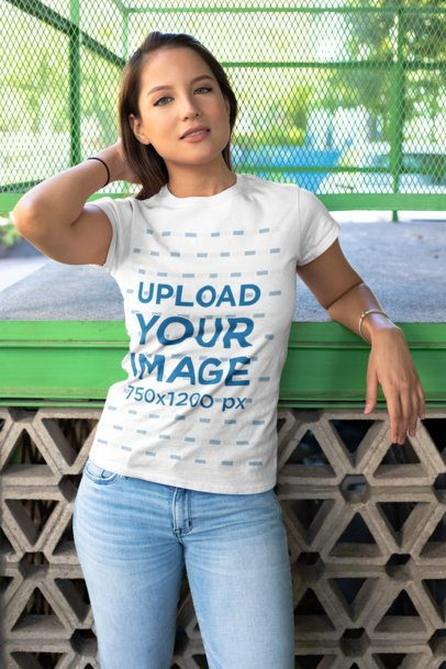 T-Shirt Mockup of a Young Woman Fixing Her Hair 28206