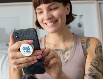 Phone Grip Mockup of a Smiling Short-Haired Woman Looking at Her Phone 28153