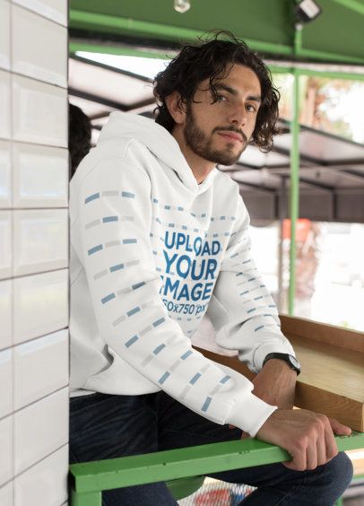 Hoodie Mockup with a Customizable Sleeve Featuring a Long-Haired Man 28305