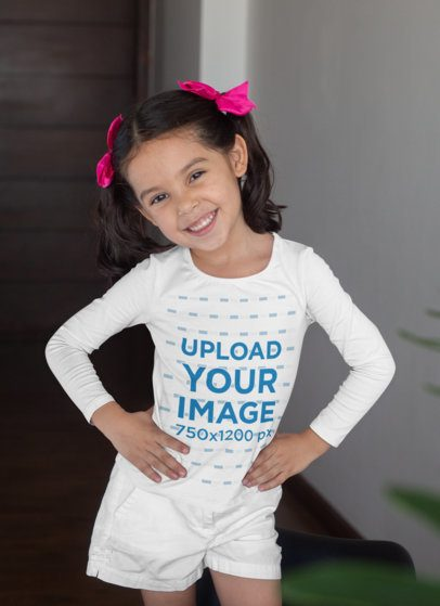 Long Sleeve Tee Mockup Featuring a Little Girl Posing at Her House 28096