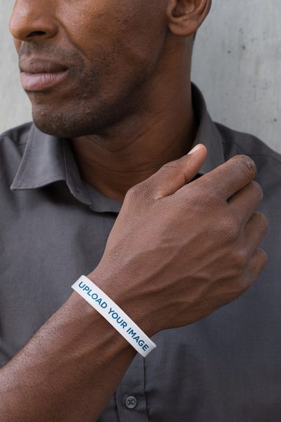 Mockup of a Man Showing off His Silicone Wristband 28230