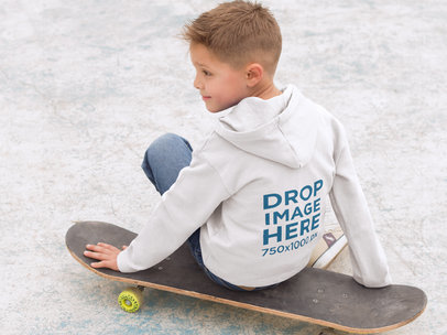 Back of a Kid's Pullover Hoodie Mockup Sitting on a Skateboard a9117b