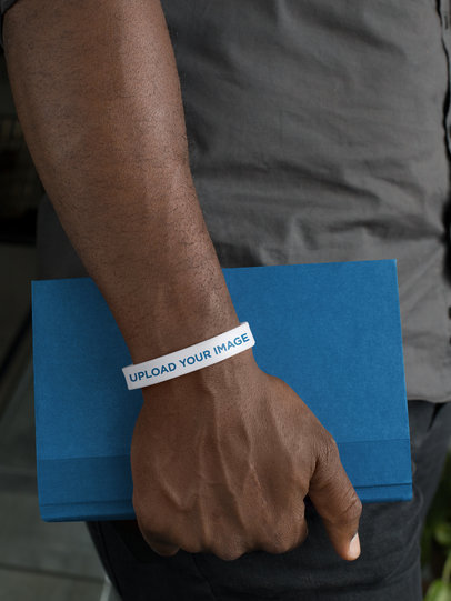 Silicone Wristband Mockup of a Man Holding a Book 28233
