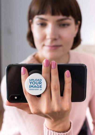 Phone Grip Mockup of a Woman Holding Her Cellphone in Landscape Mode 28156