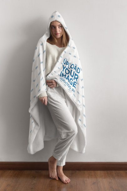 Hooded Blanket Mockup of a Woman Posing Against a White Wall 28127