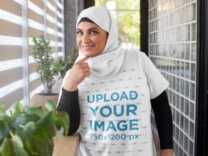 T-Shirt Mockup of a Woman Wearing a Hijab in a Hallway 28282