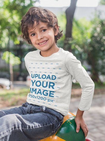 Long Sleeve T-Shirt Mockup Featuring a Smiling Kid at an Urban Playground 28123