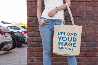 Tote Bag Mockup of a Woman Leaning on a Brick Wall 190-el