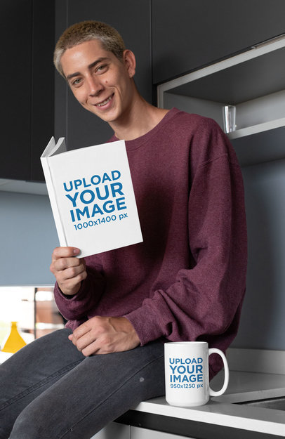 Mockup of a Young Man Holding a Book and Sitting Next to a 15 oz Coffee Mug 28458