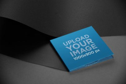 Mockup of a Digipak Lying Against a Monochromatic Background 28336
