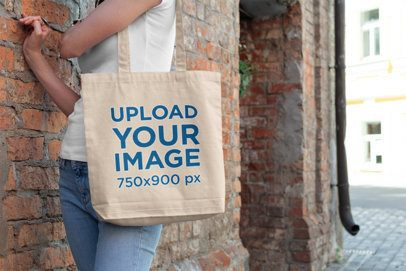 Tote Bag Mockup Featuring a Woman Standing by a Brick Wall 193-el