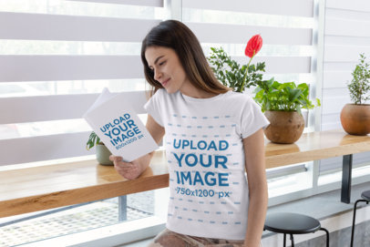 T-Shirt Mockup of a Woman Reading a Book at a Restaurant 28487