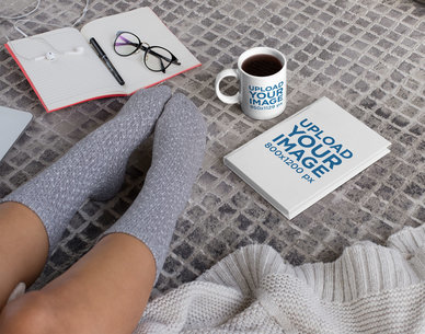 Mockup of an 11 oz Mug and a Book Placed on the Floor 28477