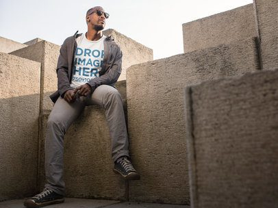 Black Man Sitting on a Modern Concrete Structure T-Shirt Mockup a9095