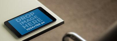 Black iPad Mini Lying on a Crystal Table Tablet Mockup a9463