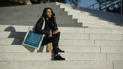 Tote Bag Video of a Woman Sitting on Concrete Stairs 13940