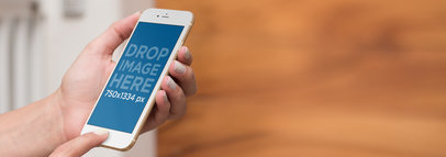 iPhone Mockup in Front of a Wooden Blurry Background a9385