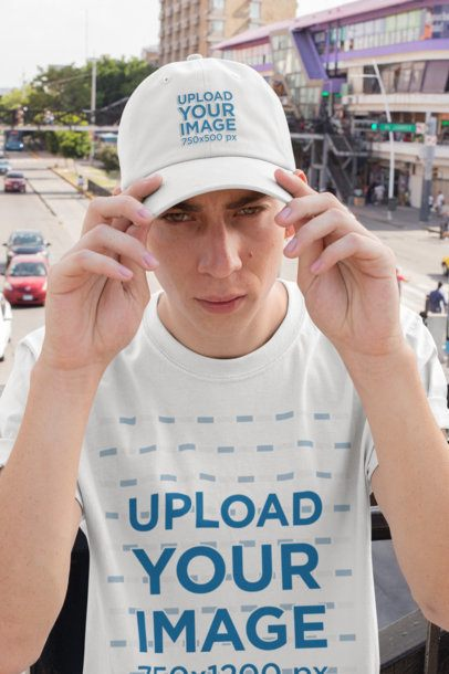 Mockup of a Young Man Wearing a Dad Hat and a T-Shirt 28590