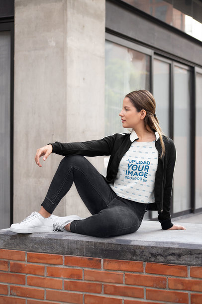 Sublimated Crop Top Mockup Featuring a Woman Posing Against a Gray Wall 28555