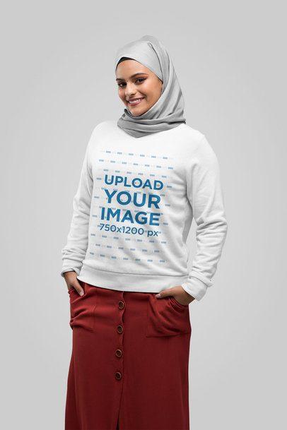Sweatshirt Mockup of a Woman with a Hijab Posing at a Studio 28390