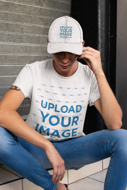 T-Shirt Mockup of a Tattooed Young Man Wearing a Dad Hat 28595