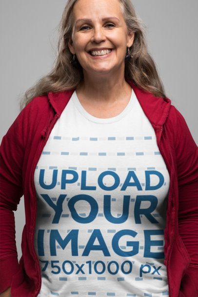 T-Shirt Mockup Featuring a Smiling Senior Woman in a Studio 28453
