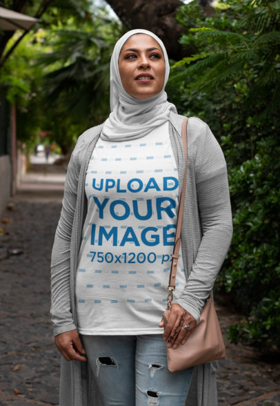 T-Shirt Mockup of a Woman Posing Proudly with a Hijab on a Street 28379